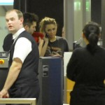 36529_Preppie_Miley_Cyrus_leaving_Hannover_Airport_in_Germany_2_122_185lo